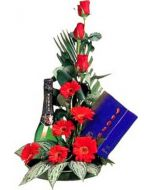 Chocolates, sparkling wine and red flowers